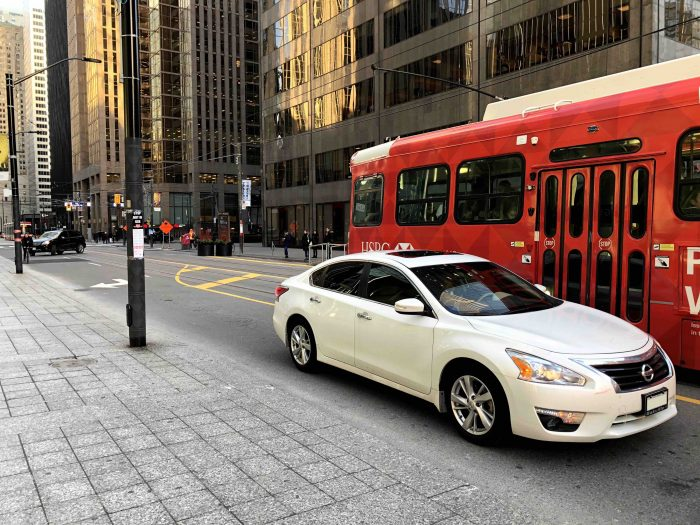 Taken on a weekday at 4:00pm, this scene would have been much more chaotic with through-traffic blocking transit before the project. Now, cars are channeled to turn right at every intersection. (Photo: Alex Gaio)
